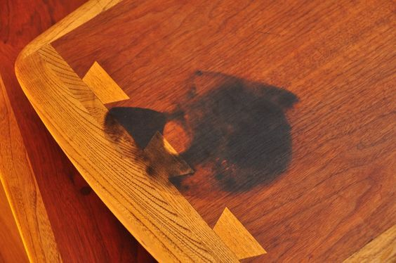 Removing Stains from Teak and Walnut Furniture--BARKEEPERS FRIEND!!  I tried this on our stained sideboard and it TOTALLY WORKED.