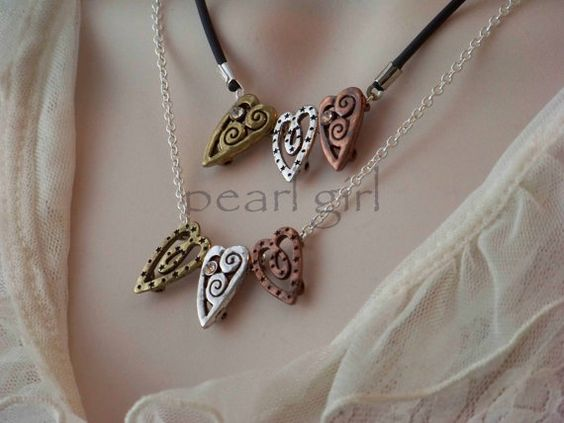 Three Crooked Hearts Necklace by pearlgirlstudio on Etsy, $10.95