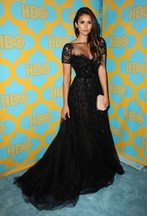 Nina Dobrev's dress is literally dripping sequins. #GoldenGlobes