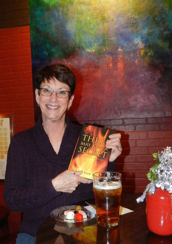 One of our happy customers enjoying her signed book and a little beverages.