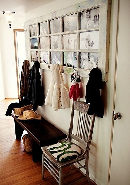An old re-purposed door is used for displaying old photos and hanging jackets in the mudroom .... #coachbarn #organizeinstyle