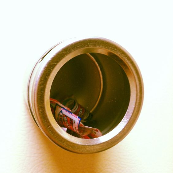 Magnetic spice jar with opening on top for box tops.