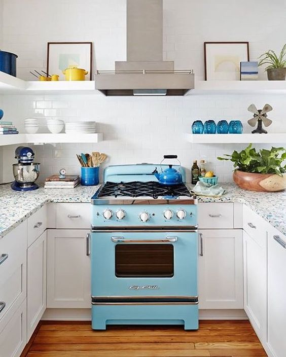 Cheery Sullivan's Island kitchen designed by one of Charleston's best @cortneybishopdesign. The whole home tour is on @coastal_living's site  by looklingerlove