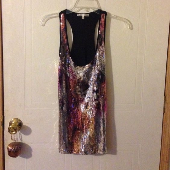 Glitzy Racerback Sequined tank top , perfect for a night out or pair with a blazer for a day time look! Tops Tank Tops