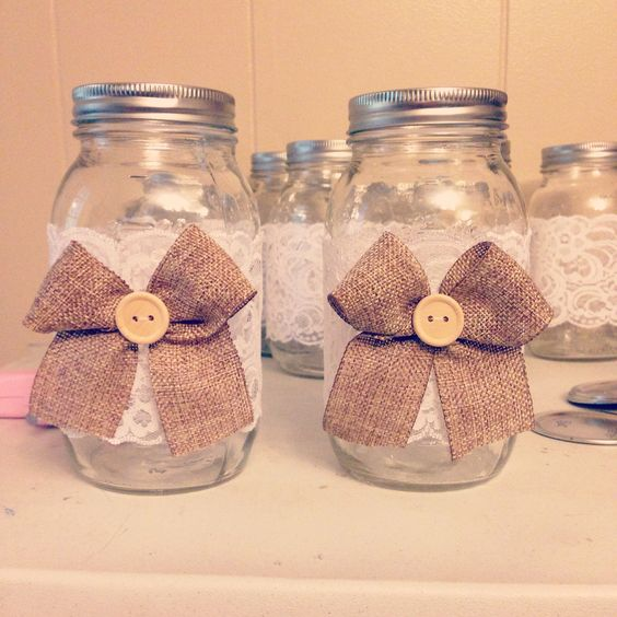 DIY center pieces just add flowers! Burlap and lace and buttons :)