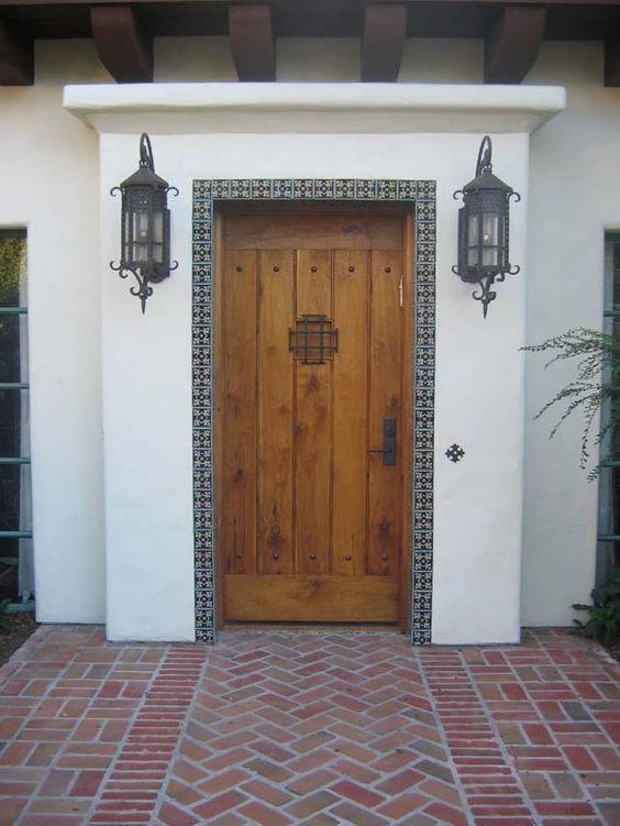 Mediterranean spanish large wooden door entryway for Mediterranean style front doors