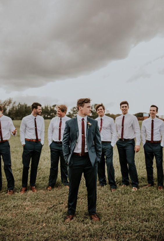 Dark suits with a pop of color from these burgundy ties | Image by Wild Heart Visuals