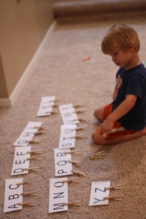 lower case letters written on clothespins, match to upper case cards. -great for fine motor skills too