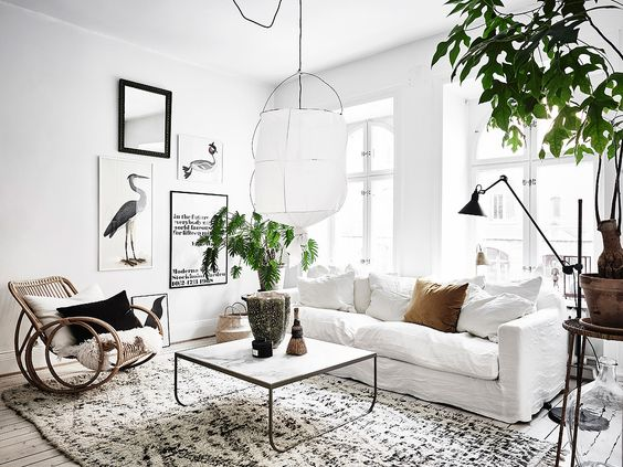 Bright Scandinavian living room with rattan rocking chair