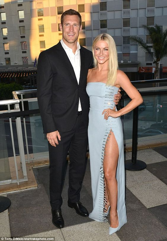 Her escort: Fiance Brooks Laich, 33, looked relaxed but dashing in a black suit…