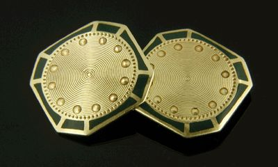 An elegant pair of green and gold cufflinks from Larter & Sons,  maker of elegant cufflinks during the early decades of the last century.  This wonderful pair features golden concentric circles surrounded by rich green enamel and gold borders.  Crafted in 14kt gold,  circa 1920.