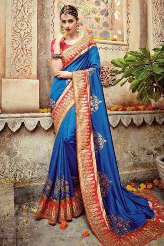 Blue Colour Pure Silk Fabric Party Wear Saree Comes With Matching Blouse. This Saree Is Crafted With Thread Work,Sequins Work,Hand Work This Saree Comes With Unstitched Blouse Which Can Be Stitched Up...
