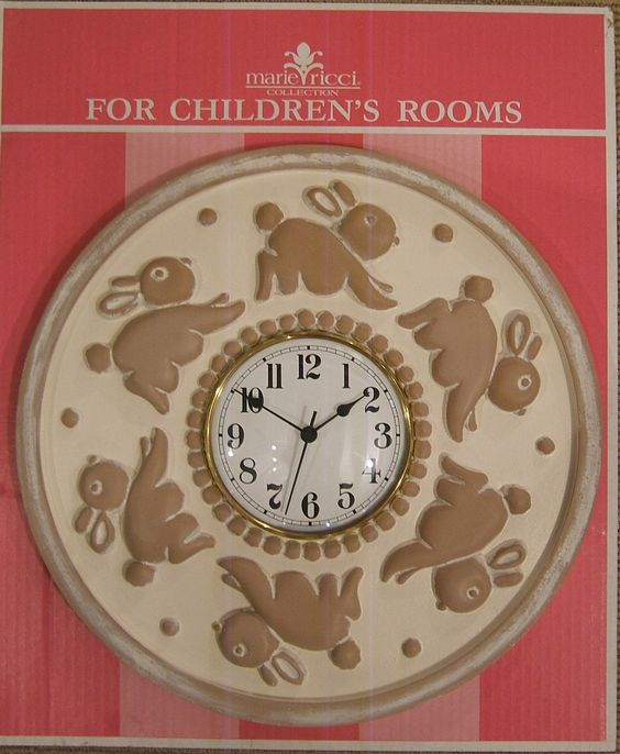 "Childrens clock in Bunny design by Marie Ricci. 18"" diameter shown in distressed ivory. Handmade and hand painted. Free Shipping $200"
