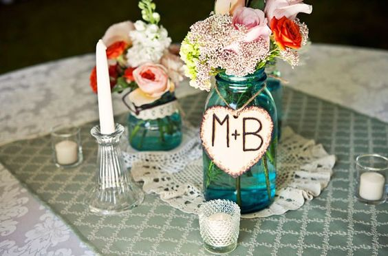 centerpieces with blue mason jars. Could have live flowers or make paper flowers! With the lace doily underneath, this is a country chic centerpiece!