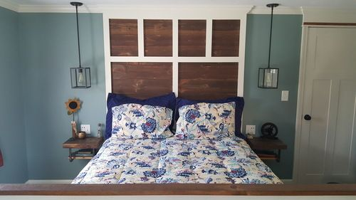Master Bedroom Remodel: Custom built headboard and footboard, floating night stands,and craftsman doors; handpicked decorations from local antique stores, light fixtures, and comforter set;crown moulding, color scheme and design style all done by A.J. McCullough Carpentry. See more below.