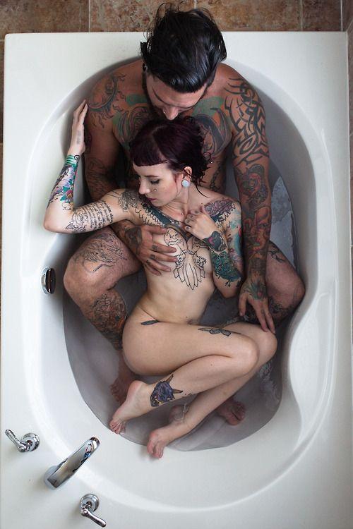 Tattoo of couple naked nudist