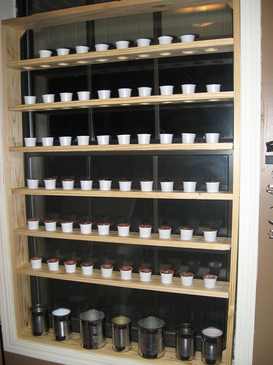 DIY Re-using K cups.....Custom made portable rack for starting seeds, fits inside a window, holds 60 k cups. Did some research and tomato seeds sprout very well in coffee grounds, and most everything else does well in a mix of grounds and potting soil. I'll start all my plants and when it warms up outside, I'll take the rack outside and leave until they are big enough to transplant. Once they're transplanted I'll use the pods to plant herbs, take them back inside for the winter, harvest them…