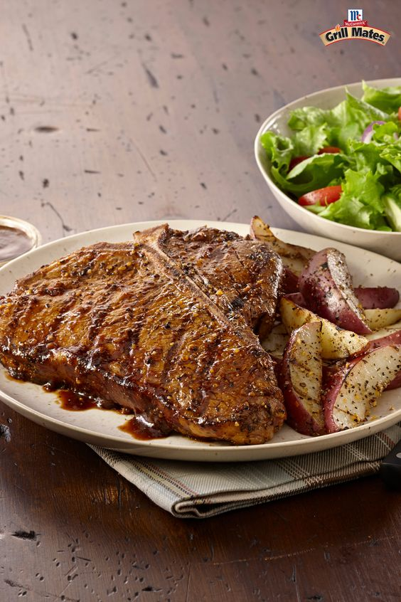 The ultimate grilled steak recipe features a T-bone layered with ...