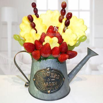 Con estos colores y este original jarrón podrías decorar cualquier mesa de dulces y boquitas