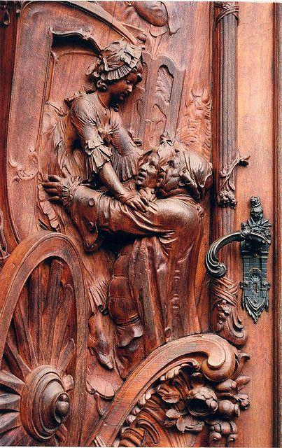 Carved wooden door in Worms, Germany.