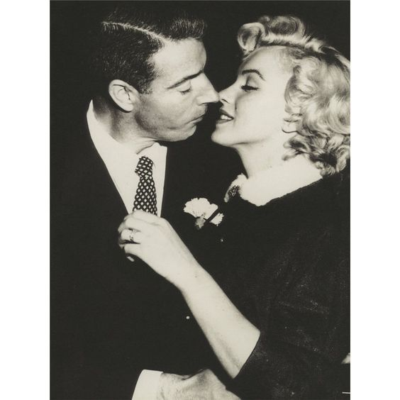 Marilyn Monroe's platinum and diamond eternity wedding band given to her by Joe DiMaggio after their 1954 wedding -   A platinum eternity band set with 35 baguette-cut diamonds (one diamond missing just as it was at the Christie's Personal Property of Marilyn Monroe sale in 1999), VS1 clarity with a total carat weight of 3.5 (when all diamonds were present), given to Marilyn Monroe by Joe DiMaggio on their wedding day on January 14, 1954.