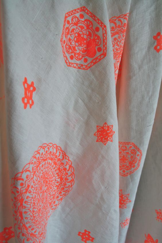 'Mandala' print in neon orange on white linen http://www.pinterest.com/vviannay/fabric/