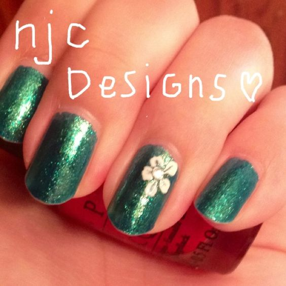My own design, teal nails, white flower with rhinestone accent!