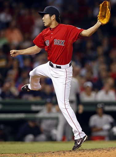 Boston Red Sox closer Koji Uehara pitches to the New York Yankees in the ninth inning of a baseball game at Fenway Park in Boston Friday, Se...