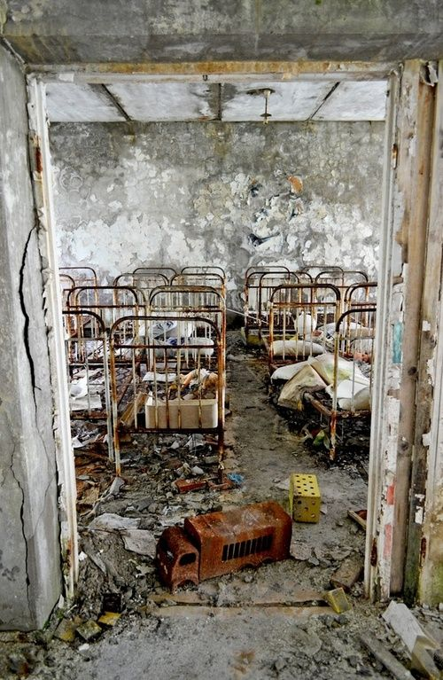 I don't know if it is true, but read somewhere that the picture is made in an abandoned children's hospital after the Tsjernobyl disaster.: