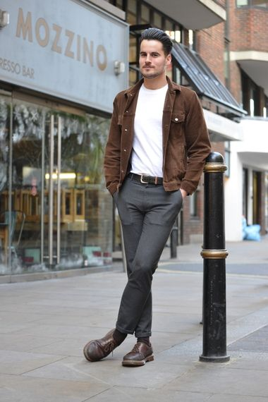 Wearing a grey textured trousers with brown leather shoes white t