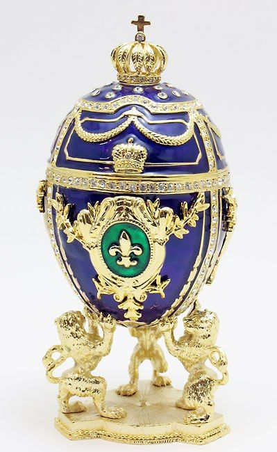 Faberge eggs (and Faberge anything really). Hideous pointless conspicuous consumption. I think I'd have stormed the Winter Palace if I'd seen these. Especially if I were living in a hovel. This one's got a fleur de lys as well- double whammy.