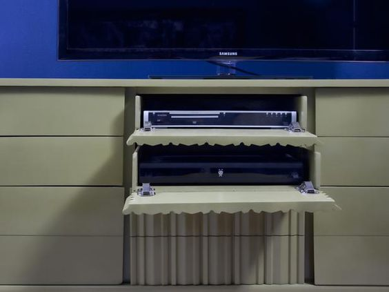 How to Turn a Dresser Into a Media Console  Turning a dresser into a media console that looks just as sleek at the flat screen above it is easy. Just follow these step-by-step instructions.    By Brian Patrick Flynn, Decor Demon    HGTV