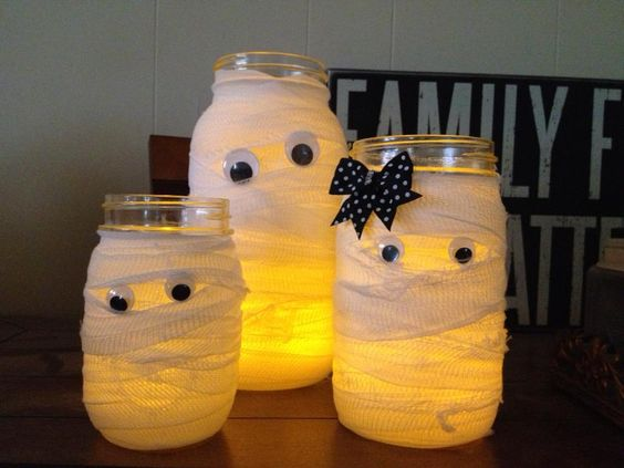 A jar (you can really use anything), some medical gauze, and googly eyes.  Embellish as you please.  I cut the gauze into strips to achieve the frayed look.