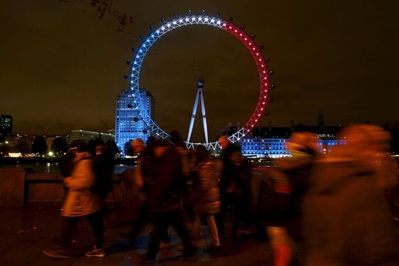 The colours of France's national flag are projected onto the London Eye. - 14th November 2015