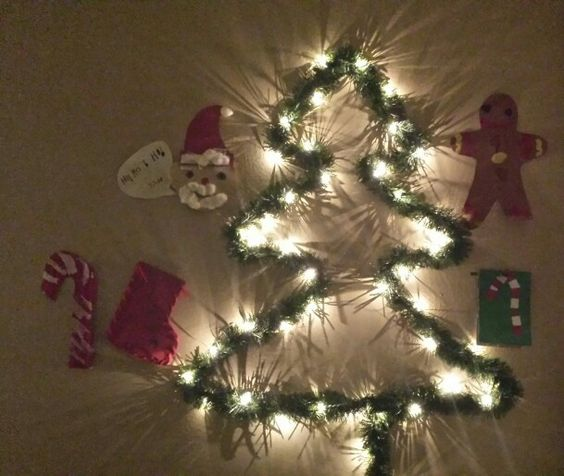 Our first Christmas tree wall. Used art work from his kindergarten class. An easy and fun project I did with my 5 year old. He has a Christmas tree wall in his room. He was more psyched about this than having an actual tree! Cost us $10.50!!!