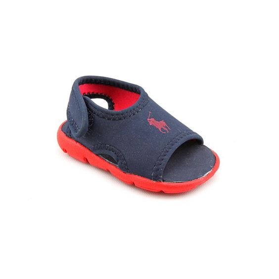 Ralph Lauren Layette Cove Width - MediumTrue Color - Navy/Red Outsole Material - EVA Heel Height - 0.5 Inches Style Description - Kids won't be fearful of the water in these Cove sandals from Ralph Lauren Layette. These sandals feature a soft nylon upper with a logo accent and an adjustable slingback strap. The treaded foam outsole is cushy and water-friendly.
