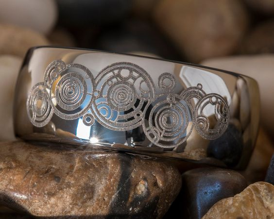 Doctor Who: Gallifreyan ring - this Etsy store has lots of cool tungsten bands, all kinds of fandoms.