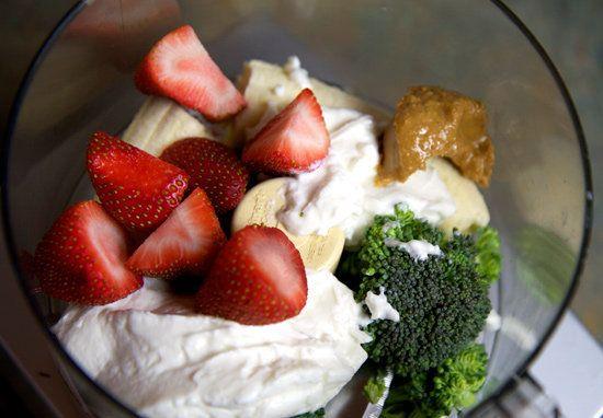 1 medium ripe banana 6 strawberries, green parts cut off 3 raw broccoli florets, stems cut off 6 ounces vanilla Greek yogurt 1/2 tablespoon smooth peanut butter