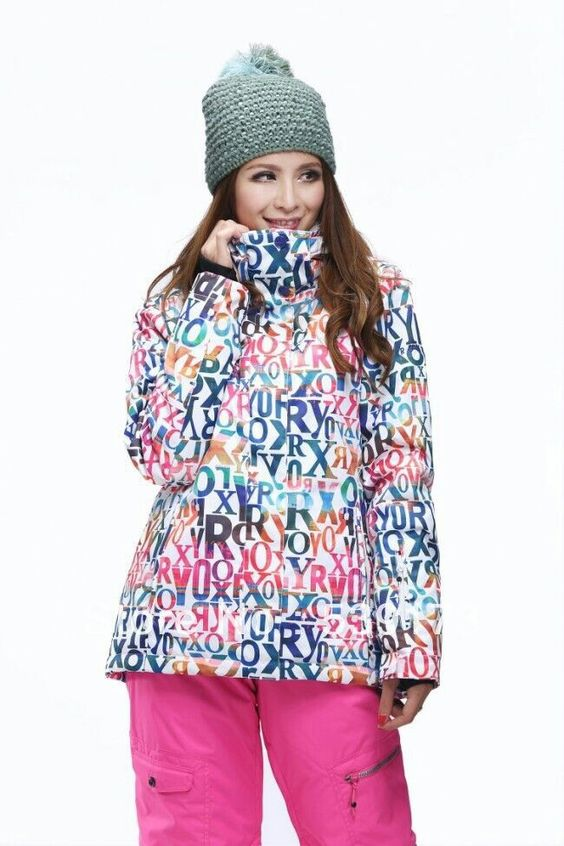Ryoko in a ROXY ski jacket with lettering of pink, emerald, eggplant,  tangerine,  & yellow.