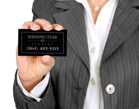 Business Woman holding Shining Star Studios Business Card