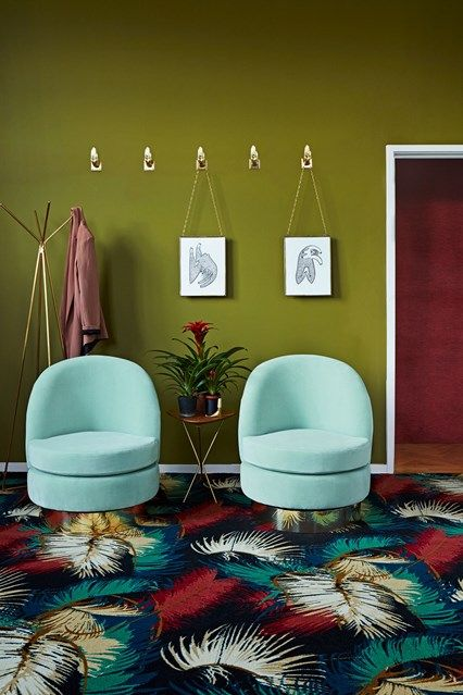 Olive green hallway with twin armchairs in Hallway Ideas. Olive green hallway in palm beach style with twin armchairs, patterned carpet and print hanging from hooks.