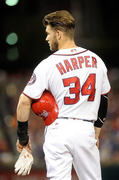 Bryce Harper of the Washington Nationals holds his Under Armour batting gloves during the game against the Chicago Cubs at Nationals Park on June 14...