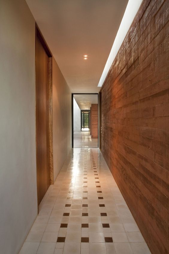 Vivacious Square Twins Chalet Surrounded by Tropical Plants: Narrow Hallway Design At Hacienda Bacoc Residence With Wooden Plank Wall And Wooden Door Also Hidden Ceiling Lamp Design ~ SFXit Design Architecture Inspiration:
