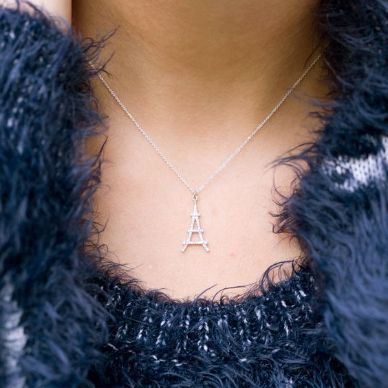 this graceful 14k rose gold necklace features an Eiffel tower pendant, covered with sparkling diamonds I NEWONE-SHOP.COM
