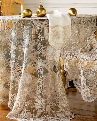 chantilly lace table linens add an elegant touch in the dining room