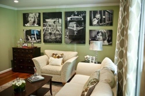 """Photo display wall example from Houzz.com which has the largest interior decor collection of photo files I have ever seen. Worth a visit to the website. Get your """"Pin It"""" button ready!"""