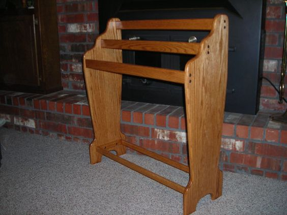 A wonderful quilt rack that will sit next to your wall and display 3 quilts.  Check it out!