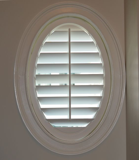What can you do with an oval window a shutter of course for Window treatment for oval window