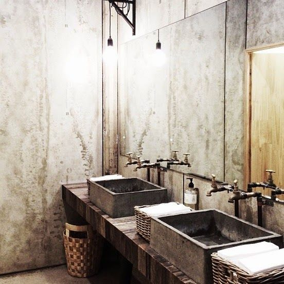 Exposed pipe & faucets: Bluestone sinks; reclaimed 2x6 wood laminate Counter; Concrete walls; Frame-less mirrors. DONE! Méchant Studio Blog: bathroom time