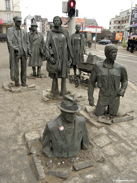 The Anonymous Pedestrians Sculpture  in Wroclaw, Poland - art by Jerzy Kalina;  there are 14 statues representing Martial Law in 1981 in Poland, when many people went 'underground' or disappeared in the middle of the night (courtesy of the militia), and later returning ;  photo by bartoszewicz: